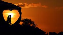 Couple On The Heart Shape Rock...