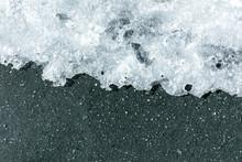 Melting Ice On Asphalt In The ...