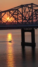 Sunset In Louisville (Ohio River) Boat And Bridge