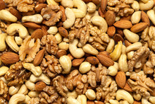 Assorted Nuts Background. Waln...