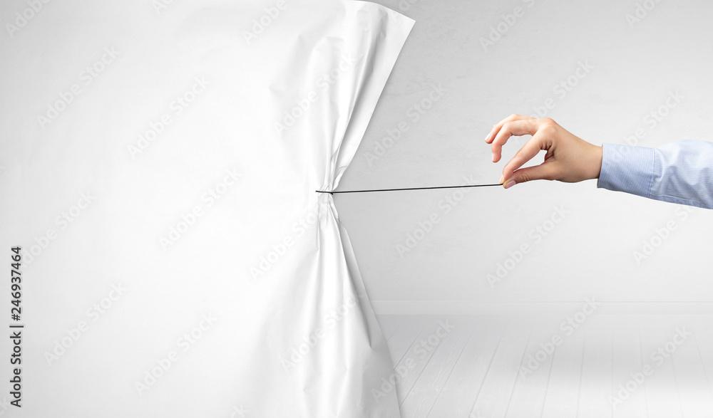 Fototapeta hand pulling white paper curtain, changing scene concept
