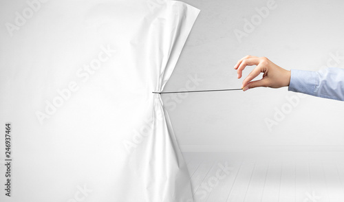 Obraz hand pulling white paper curtain, changing scene concept - fototapety do salonu