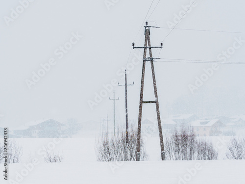 Fototapeta Power lines in the snowstorm in Ebbs, Tirol, Austria