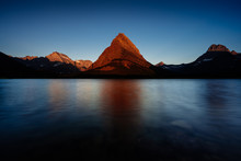 A Mountain At Sunrise In Glacier National Park, Montana