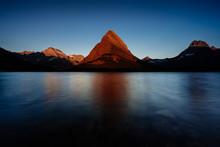 A Mountain At Sunrise In Glaci...