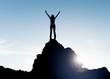 Leinwandbild Motiv Woman standing at a summit