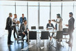 multiracial business people discussing negotation in the office with panorama window. commercial conversation