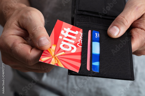 Fototapeta Human Hand Removing Gift Card From Wallet obraz