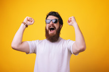 Portrait Excited Bearded Man In Sunglasses Standing With Fists Up Adn Screaming