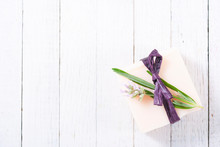 Soap Bar And Lavender Flowers On White Wood Table Background