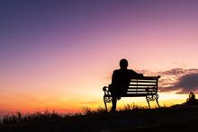 Silhouette Of Woman Sitting Al...