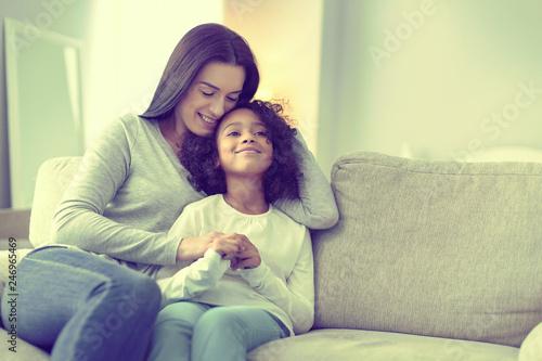 Fotografía  Proud beautiful woman embracing her adorable baby girl.