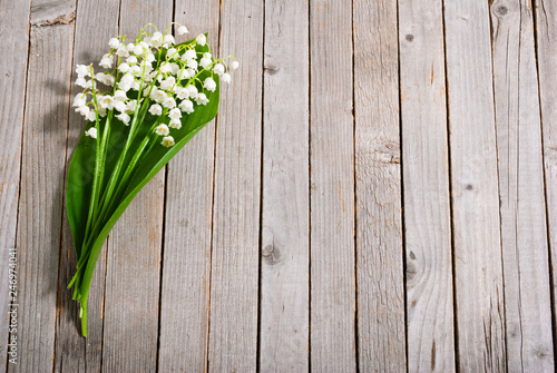Poster Muguet de mai bouquet of lily of the valley on old weathered wooden table background