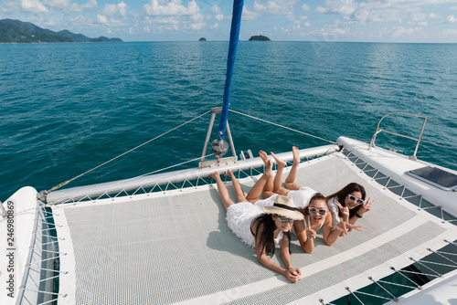 Fotografie, Obraz Lifestyle series: Group of Asian women on catamaran yacht