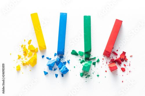 Fotografie, Obraz  the four colour of broken chalks, crayon or pastel stick on white rough paper