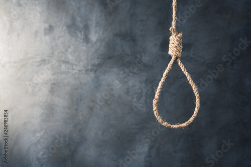 the noose against grunge wall background, failure or commit suicide concept Fototapet