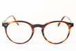 canvas print picture - Brown styled glasses close-up isolated on white background