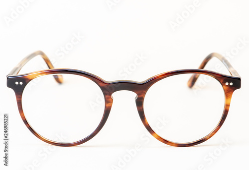 Brown styled glasses close-up isolated on white background