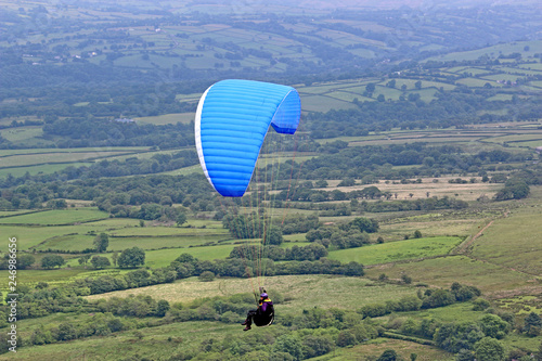 Paraglider flying in the Brecon Beacons