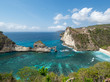 Indonesia, november 2018: Beautiful scenic panoramic landscape view of exotic Atuh beach of Nusa Penida Island in Bali. Palm trees,turquoise clear water and warm white sand beach. Popular destination.