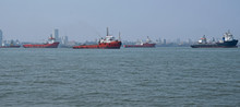 Commercial Shipping At Anchor In The Arabian Sea Off The Coast Of Mumbai, India, Which Is The Busiest Port In South Asia
