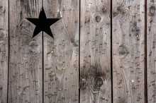 Old Vintage Wooden Wall With Star Shaped Hole