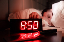 Alarm Clock On Bedside Table W...