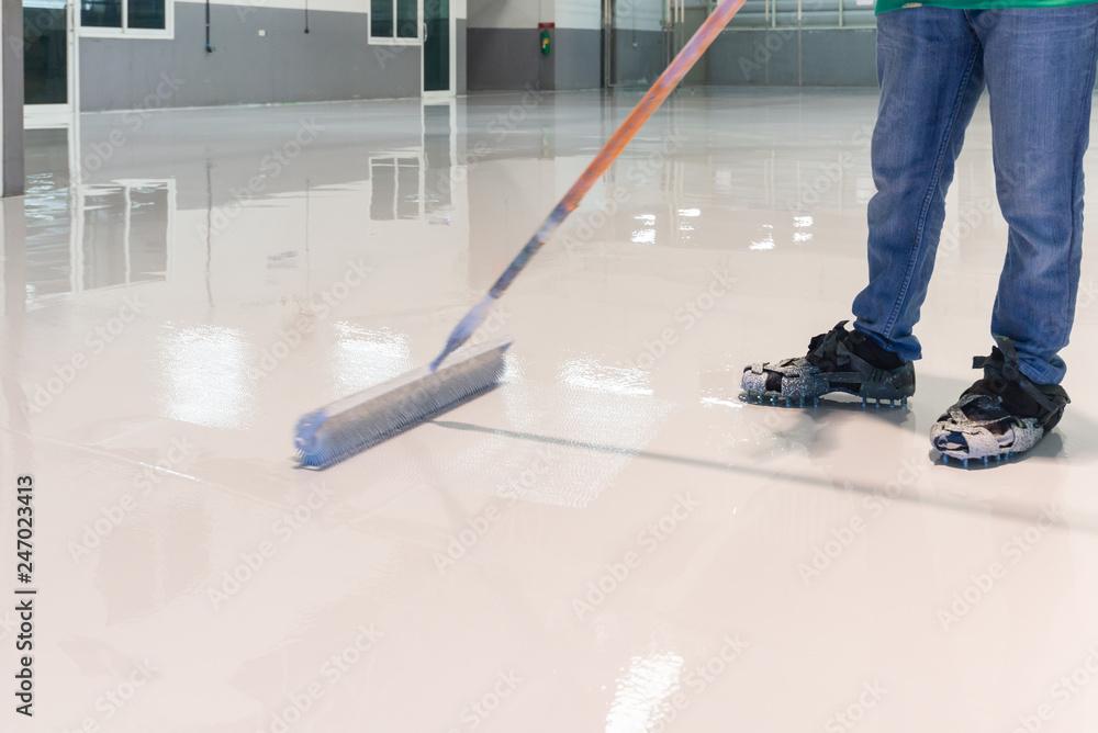 Fototapeta Construction series: Worker working on epoxy floor