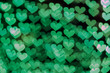 Green background with bokeh hearts