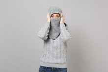Young Woman In Gray Sweater Wrapping Covering Face With Scarf Put Hands On Head Isolated On Grey Background. Healthy Fashion Lifestyle People Sincere Emotions, Cold Season Concept. Mock Up Copy Space.