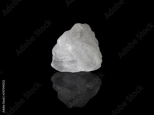 Photo White Alum crystal isolated on black background