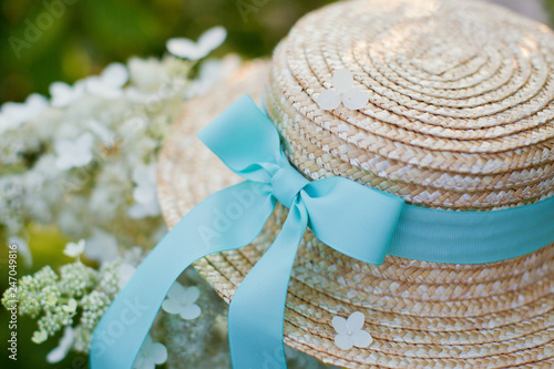 Boater straw hat with blue ribbon Canvas Print