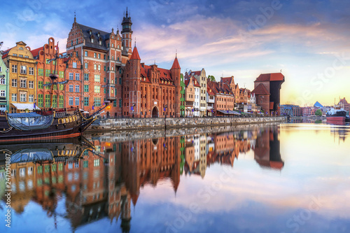 obraz PCV Gdansk with old town and port crane reflected in Motlawa river at sunrise, Poland.