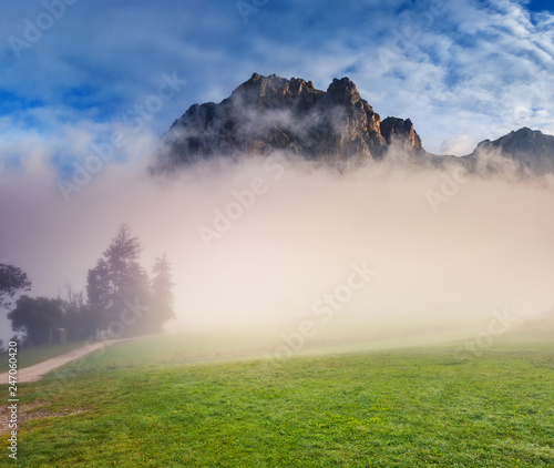 Great view of the foggy Tofane range from Falzarego pass.Location place Dolomiti, Italy, Europe.