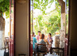 Friends get lunch on the patio of a restaurant