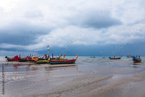 Deurstickers Asia land Colourful boats on the sand beach in Phuket, Thailand