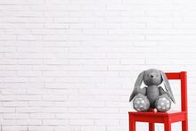 Stuffed Toy Rabbit On Chair Ag...