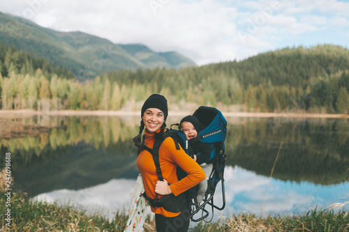 Stampa su Tela A mother hiking in the Canadian mountains with her baby on her back