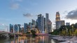 Singapore time lapse 4K, city skyline day to night sunset timelapse at Marina Bay waterfront business district