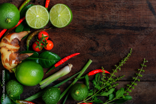 Poster Aromatische Herb and spicy ingredients for making Thai food. Recipe book with fresh herbs south asia and spices on wooden background, (concept thai food),top view