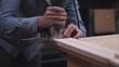 Guitar maker carve wood to insert truss rod