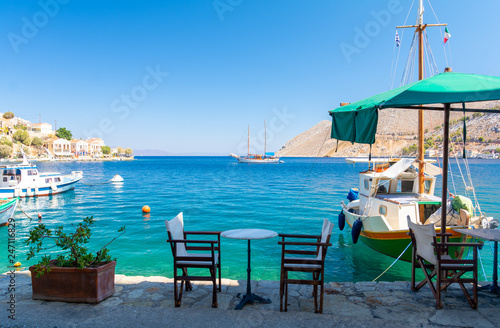 Traditional small street taverna in Symi island, Greece Canvas Print