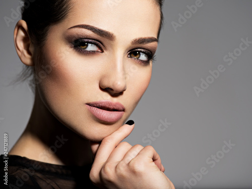 Fotografie, Obraz  Face of a beautiful girl with smoky eyes makeup