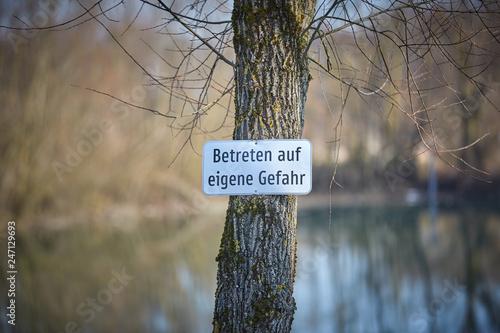 Photo  lake with warning Betreten auf eigene Gefahr