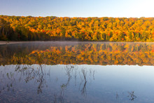 Autumn Lake Reflections. Vibrant Fall Foliage Reflected In The Clear Water Of Monocle Lake In The Hiawatha National Forest In The Upper Peninsula Of Michigan.