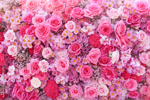 Colorful multicolored ornamental of beautiful pink roses blooming patterns group with  daisy and  carnation texture on wall for background - 247140093