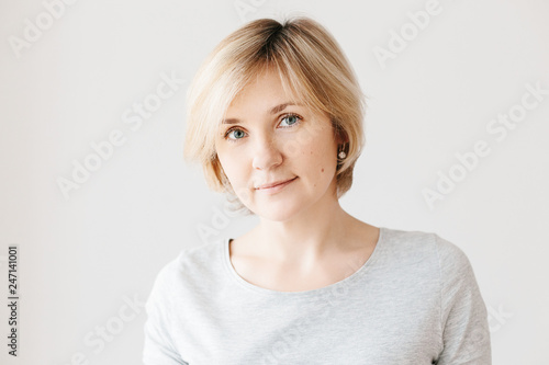 Middle aged woman on light background