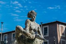 Fontana Delle Naiadi Statue Of A Woman Holding A Goose At Piazza Della Repubblica In Rome, Italy