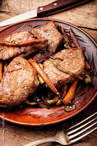 Beef steaks with vegetables