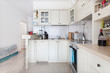 Modern bright domestic classic kitchen interior with with appliances